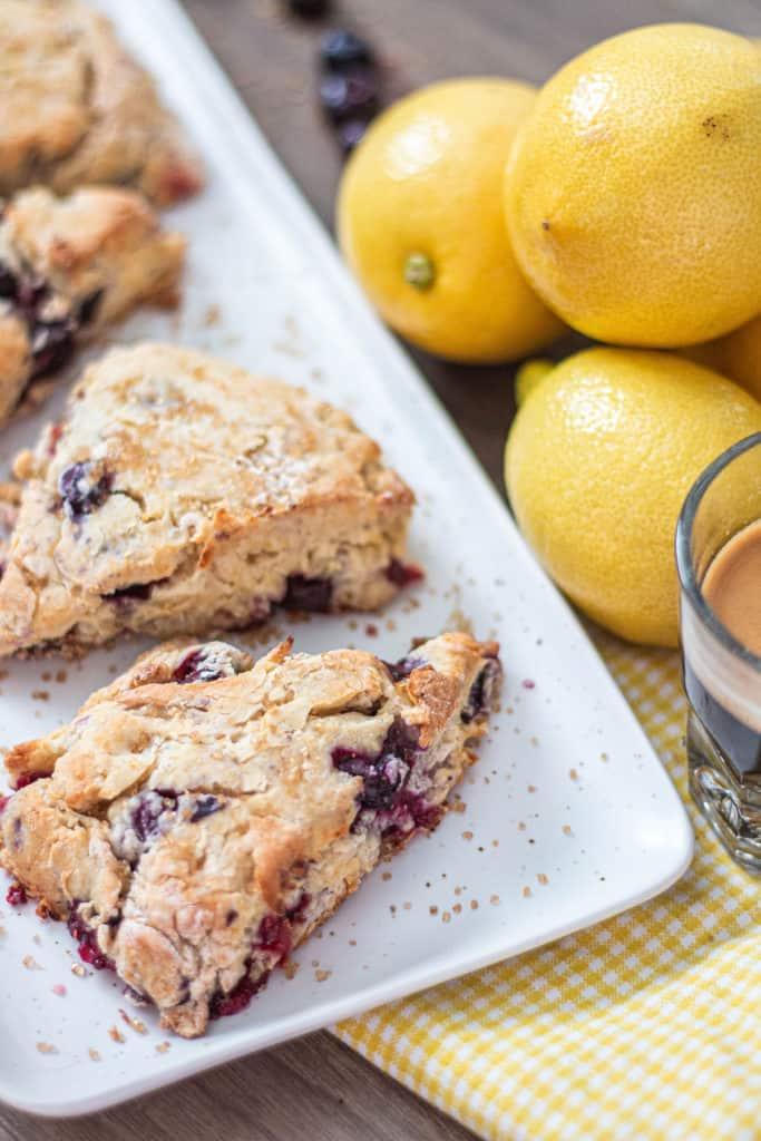 Fresh Homemade Blueberry scones with lemons blueberry and a shot of espresso.