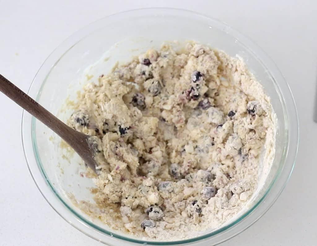 Blueberry lemon scone dough in mixing bowl