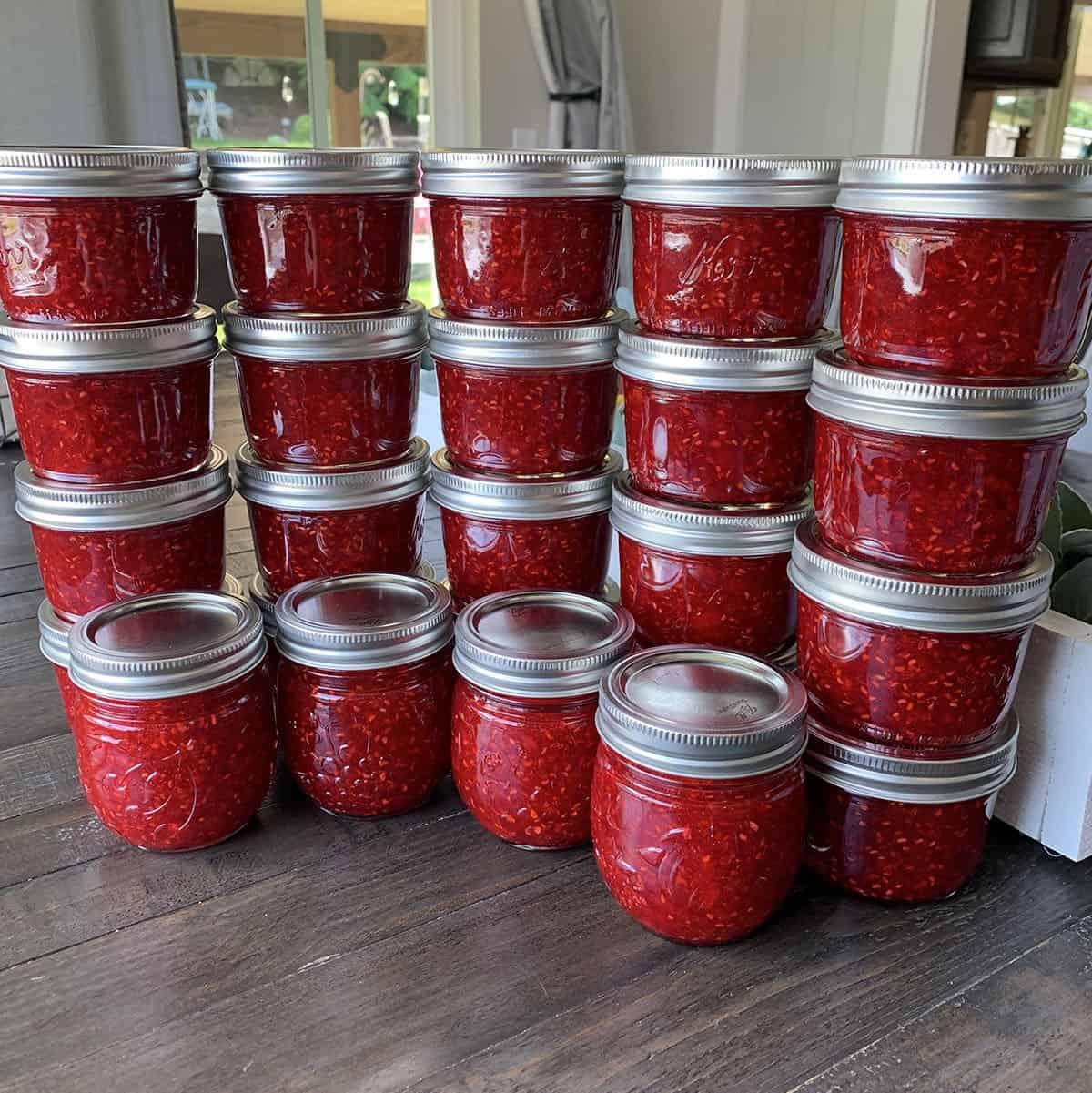 Homemade raspberry freezer jam from freshly grown raspberries.